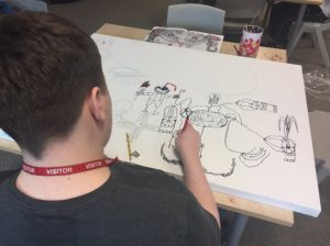 Boy with autism drawing